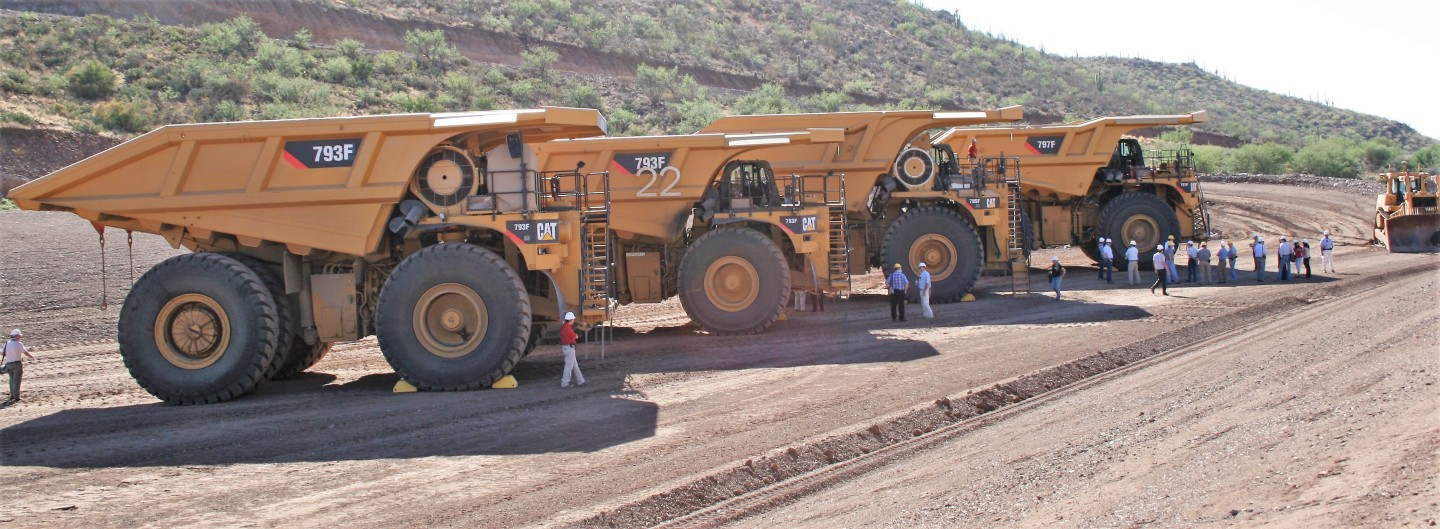 Caterpillar trucks line up at the company's test mine in Tinaja Hills, Arizona, US. Copyright: The Intelligent Miner