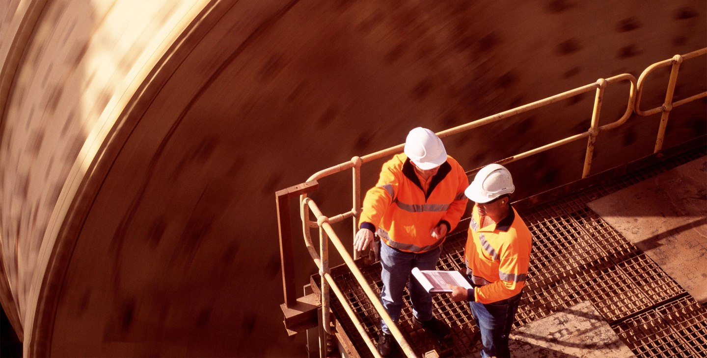 Newmont Goldcorp employees confer
