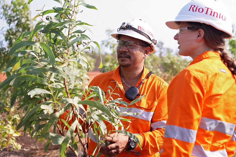 Crew leader Craig Wone and community relations advisor Lucy Warren inspecting rehabilitation at Rio Tinto's Weipa operations. Image: Rio Tinto