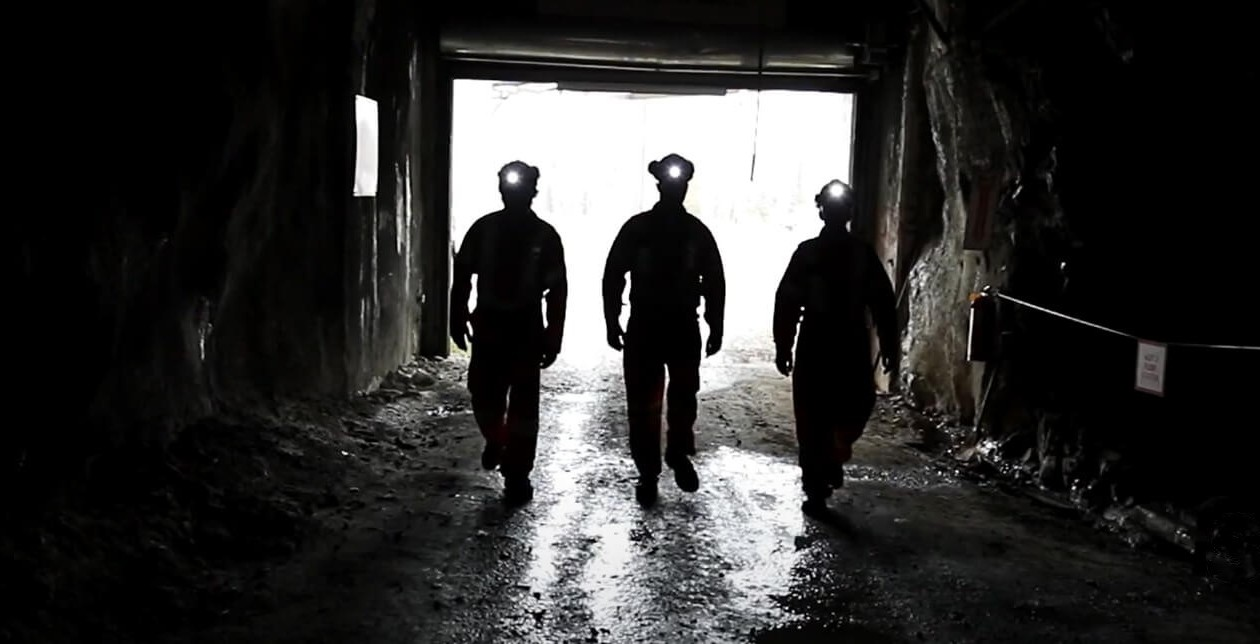 Three workers head into an underground mine. Image: Sofvie Inc.